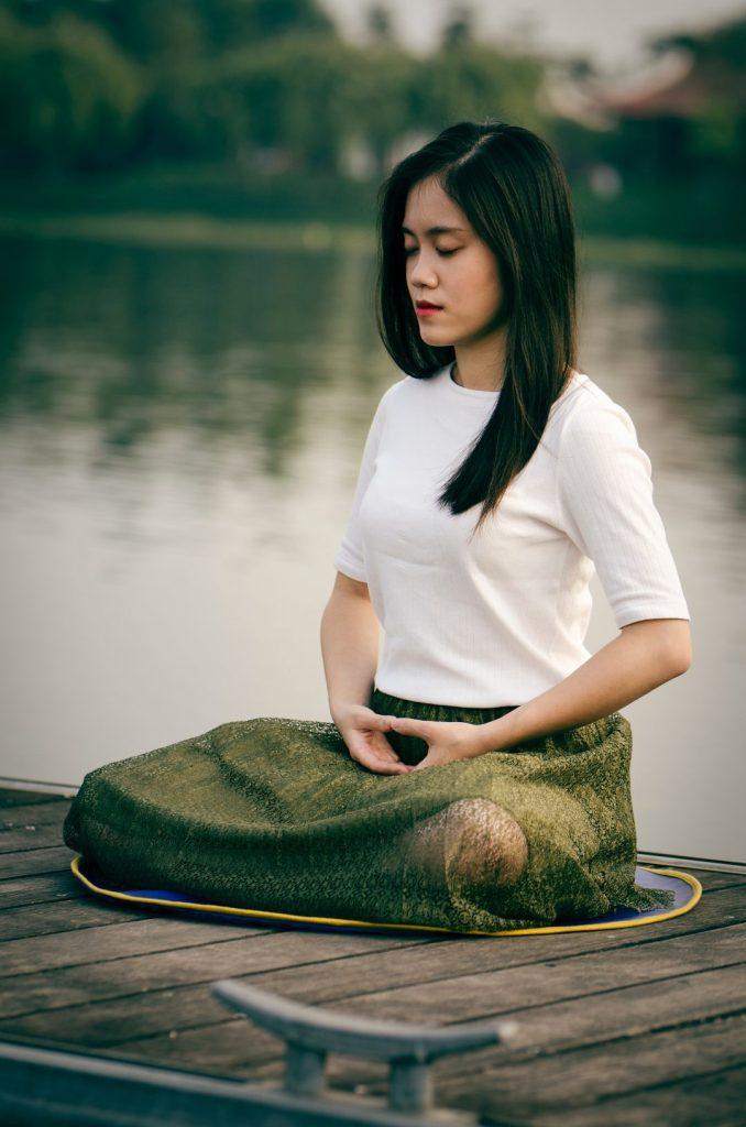 10-day-vipassana-meditation-retreat-woman-sitting-meditating-lotus-position