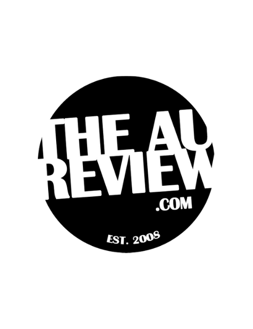 Black circle with white text reading the AU Review