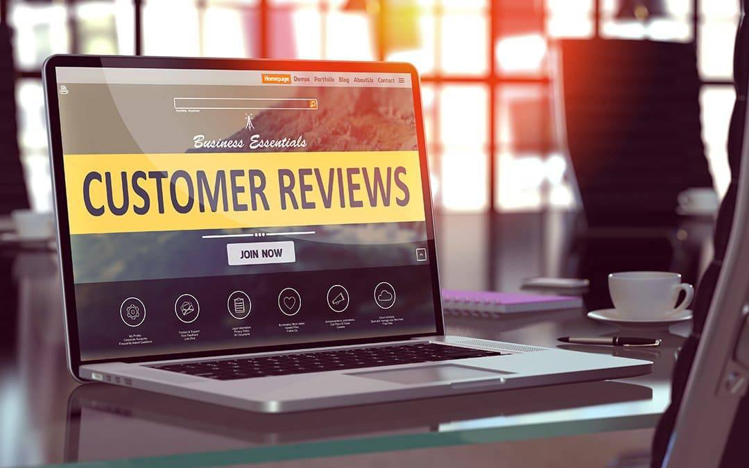 Customer Reviews landing page displayed on laptop.
