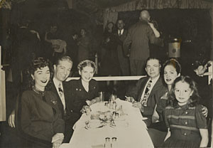 A gathering of Donna McArthur Berigan's family in 1948. L-R: Joyce McArthur and her husband, Donna's brother Darrell. After Bunny's death, his daughters went to live with Joyce and Darrell until they married. Patricia Berigan (next right) was then 16; Darrell's father John J. McArthur, youngest sister Maddie, and 12 year-old Joyce Berigan.
