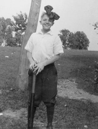 """Bernard """"Bun"""" Berigan, Lyndon Dale Island, Fox Lake, WI, June 1921. This photo was taken at a class picnic. Bunny had taken the ribbon in his hair from one of his female classmates."""