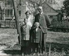 The Berigan family, Mary Catherine (Mayme), William Patrick (Cap), Donald, and Bernard; Fox Lake, WI, 1915.