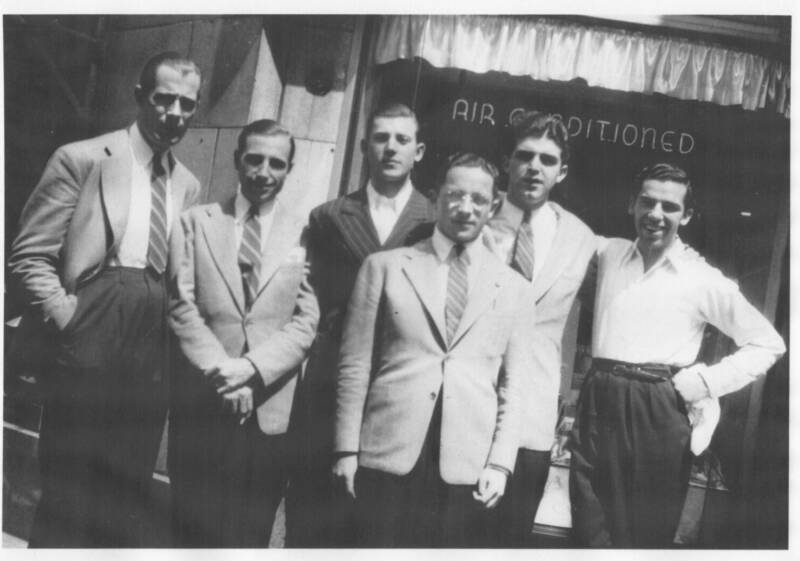 Many of Berigan's sidemen went on to very successful careers in music. In this photo taken outside the Stanley Theater in Pittsburgh in late August 1938, L-R: Hank Wayland, Clyde Rounds, Ray Conniff, Nat Lobovsky, Joe Dixon, and Buddy Rich.
