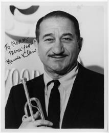 "Trumpet virtuoso Mannie Klein in the 1950s. In the early and mid 1930s in New York, Klein often worked with and substituted for Berigan in the radio and recording studios. His succinct appraisal of Berigan's impact on any band he played in: ""You didn't know sometimes if he was gonna show up for a session. But when he did show up--well, nobody played with the balls and the beat he did."""