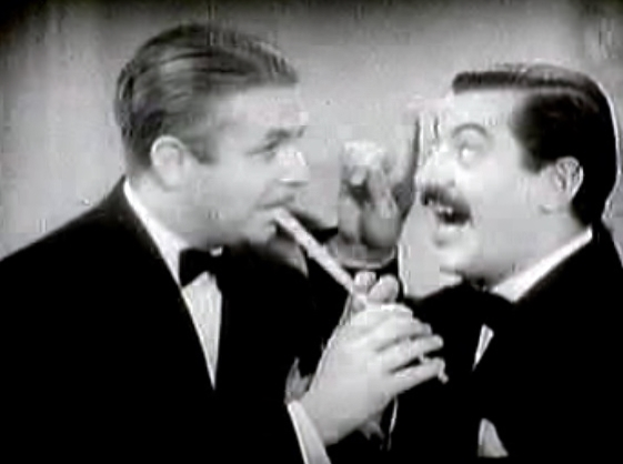 Berigan playing his tin flute with Jerry Colonna in the film short >>>>>>>>>>>>