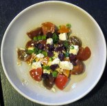 With olive oil, feta, spring onions and dried cranberries
