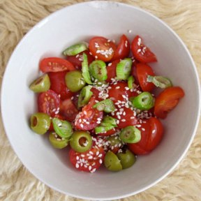 Piquant reminder - tomato, olives and spring onions.
