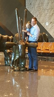 At the airport, Monkey holding on to the Oryx statue