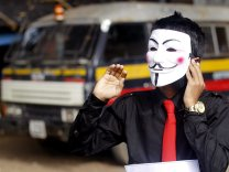 3034anonymous-mask-bus-1