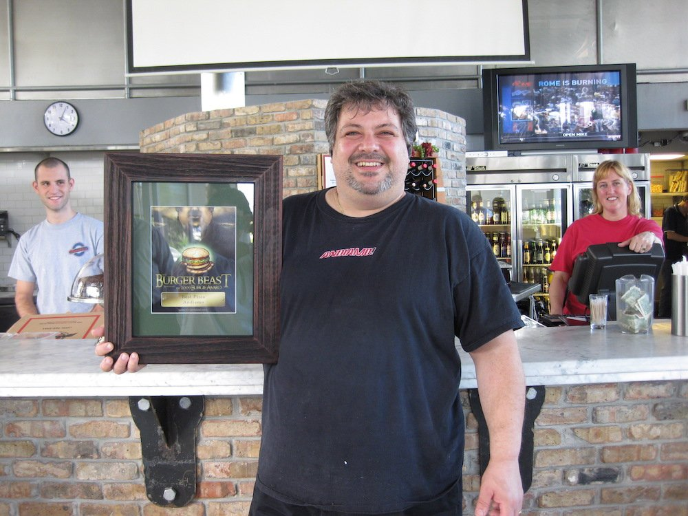 Co-owner Frankie Cupri with Andiamo's 2009 Burger Beast Burgie Award