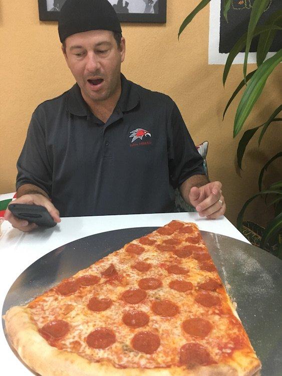 Zavier in awe of the 2 ft Pizza Slice