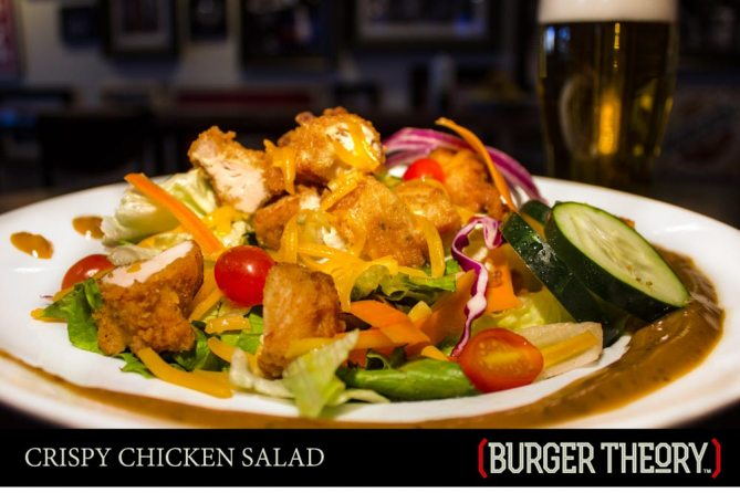 Burger Theory Phoenix - Crispy Chicken Salad - Fresh mixed greens • cucumbers • tomatoes • Cheddar cheese • crispy buttermilk chicken strips