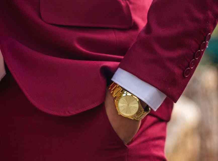 man wearing red blazer