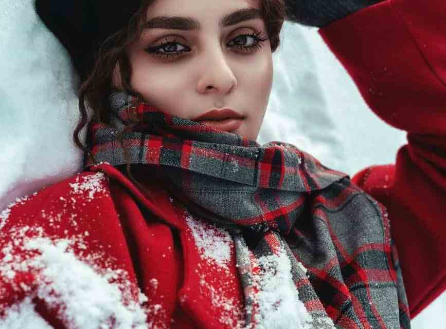 woman in red and black coat and black hat