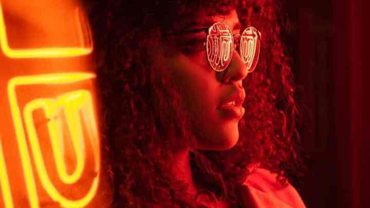 pensive woman in round eyeglasses