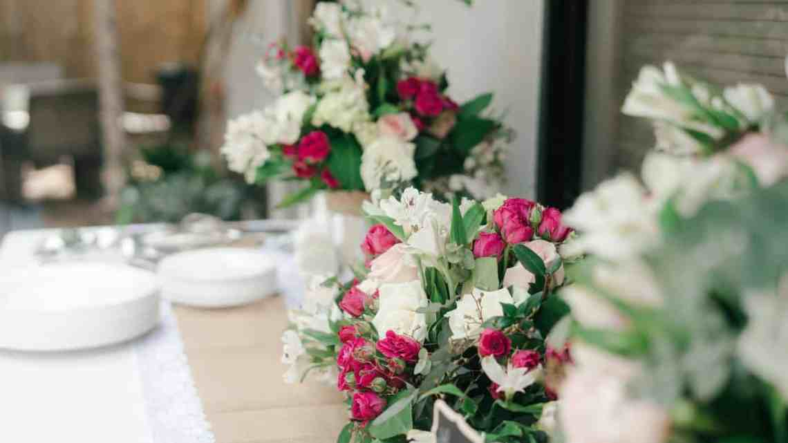 white and pink flower bouquet on white table