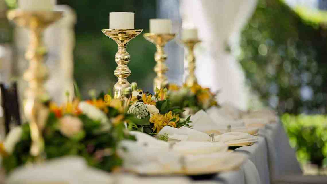 four white tealight candles on brass colored candlesticks