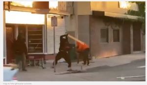 Disturbing video shows husband and wife savagely attacked by looters with 2x4s for defending business