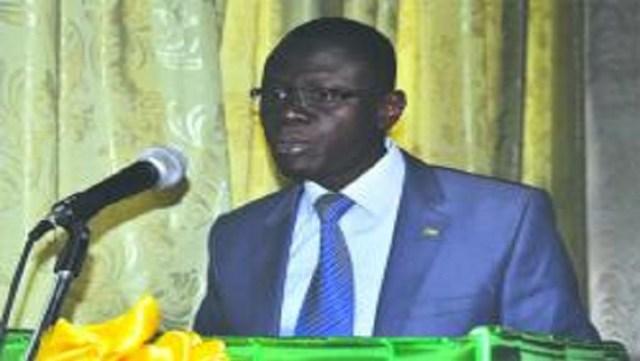 Le ministre en charge  de l'Habitat, René Bagoro