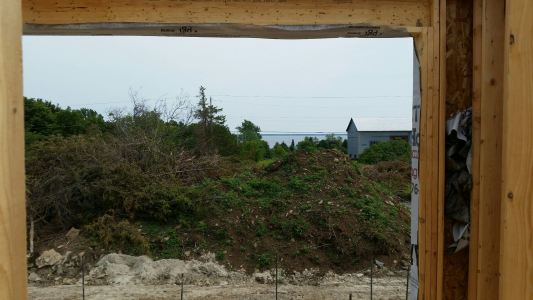the view from the living room window. It will open up once the piles of stumps etc and topsoil are gone