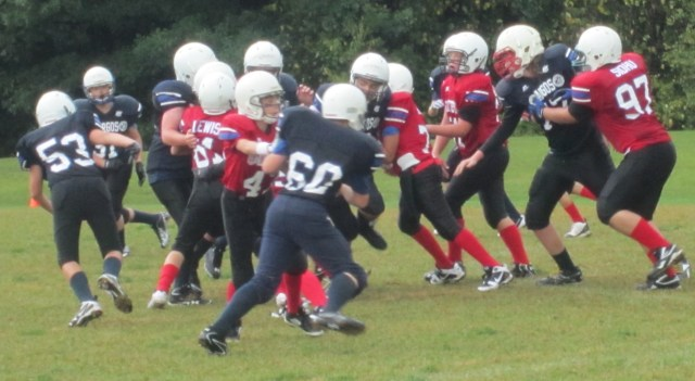 It was raining, the ground was wet, slippery and football was hard to hang onto - but the game went on.