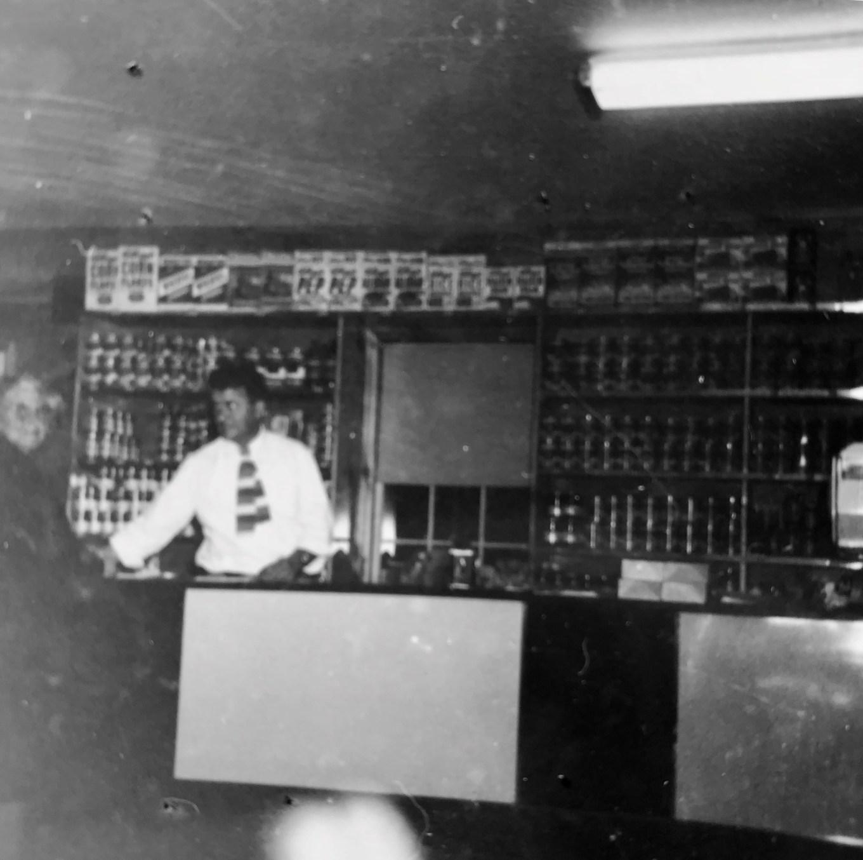 Bob Carpenter behind the counter at grand opening, Burlington MA