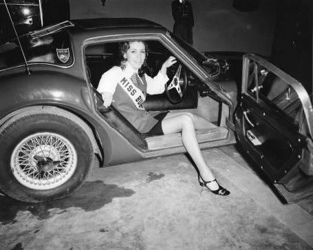 Miss Burlington in a 1968 Marcos 1600 GT