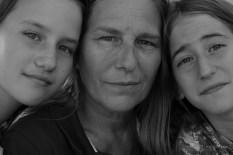 Deb Eck, with her twin daughters, works long hours managing a retail store. She became a reluctant movement leader.