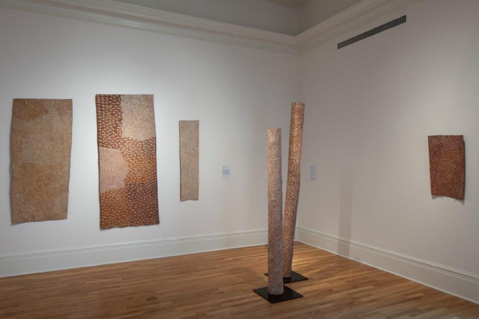 Installation view showing works by Yunupingu.