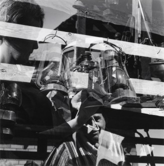 """Robert C. May, Untitled [Fence, lanterns, and figures], 1968; gelatin silver print, 6 by 6 inches. Included in """"Kentucky Renaissance"""" at the Cincinnati Art Museum."""