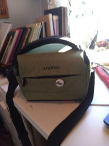 camera case with #deranged poetess badge
