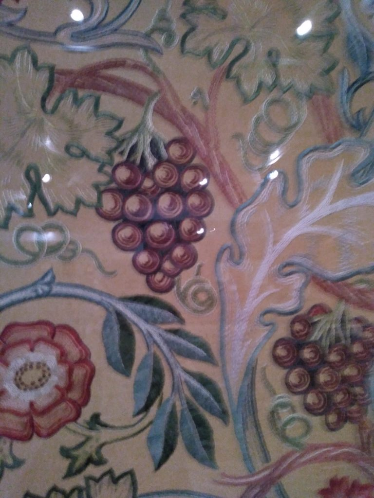 embroidery of grapes and vineleaves