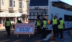 google bus protest 2 tier