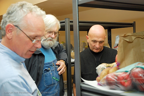 Gary Huber, Interim General Manager review orders with coop members. The first delivery day of the Iowa Food Cooperative at Merle Hay Mall. The Iowa Food Cooperative allows consumers to order local products online from Iowa producers and then pick them up at a storefront in Merle Hay Mall.