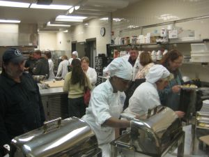 Chefs and farmers in the kitchen on Terra Madre day