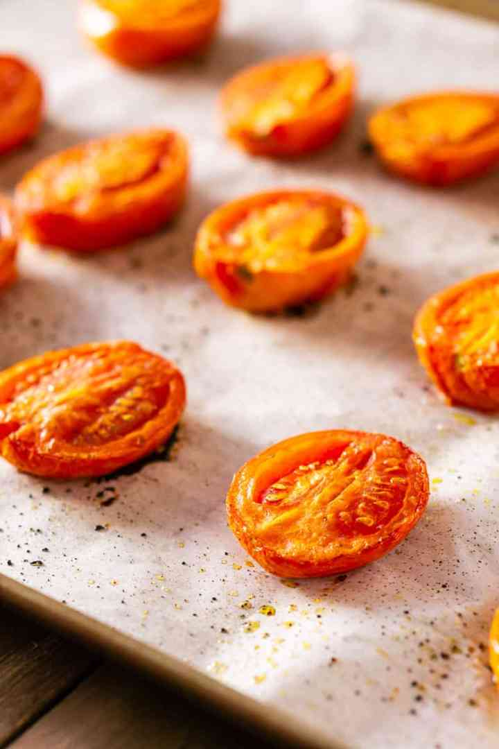 A sheet pan of roasted tomatoes.