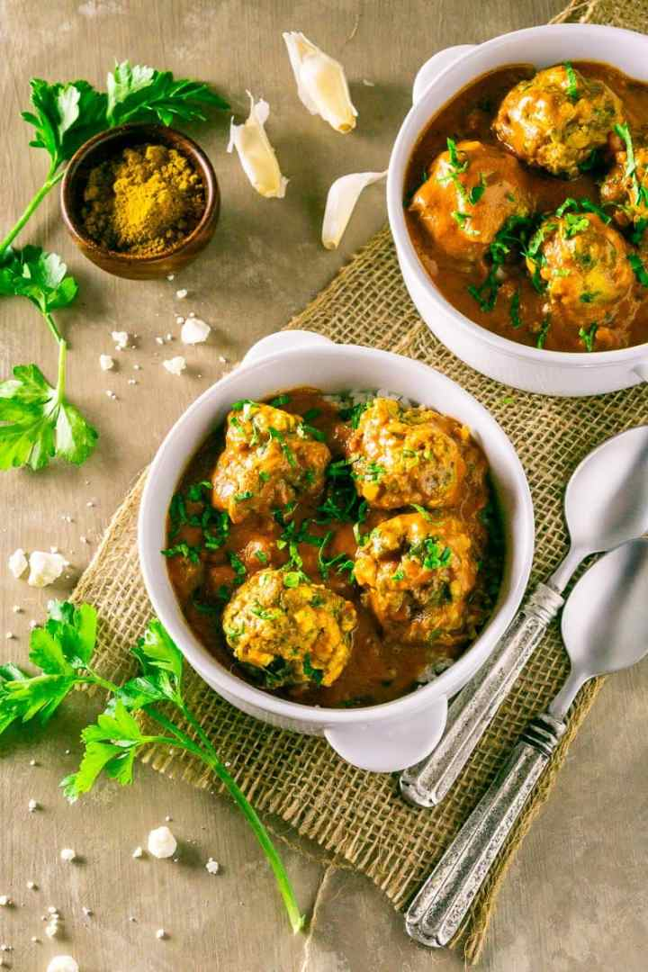An aerial shot of two bowls of curried feta-lamb meatballs.