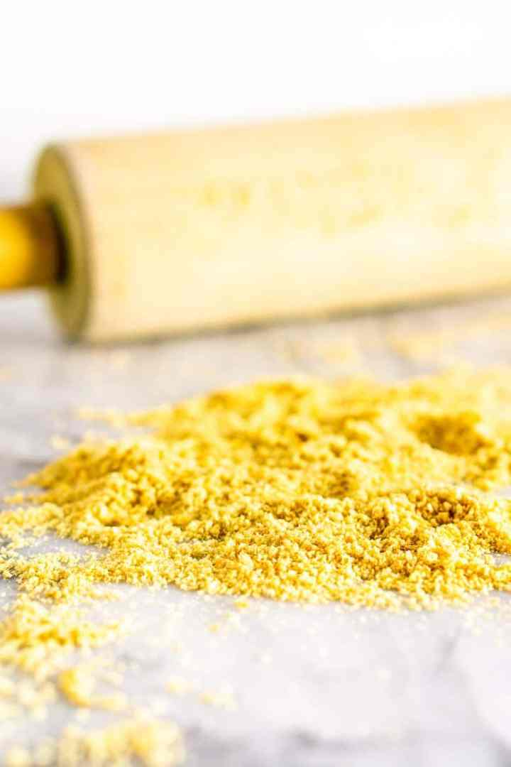 Crushed graham cracker crumbs with a rolling pin for the sparkling key lime pie martini garnish.