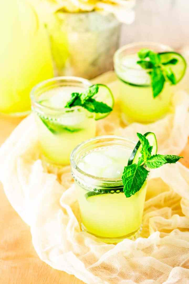 Looking down into three glasses of mint-cucumber lemonade.
