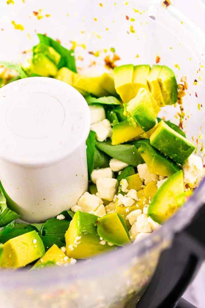 The food processor with the additional ingredients added.