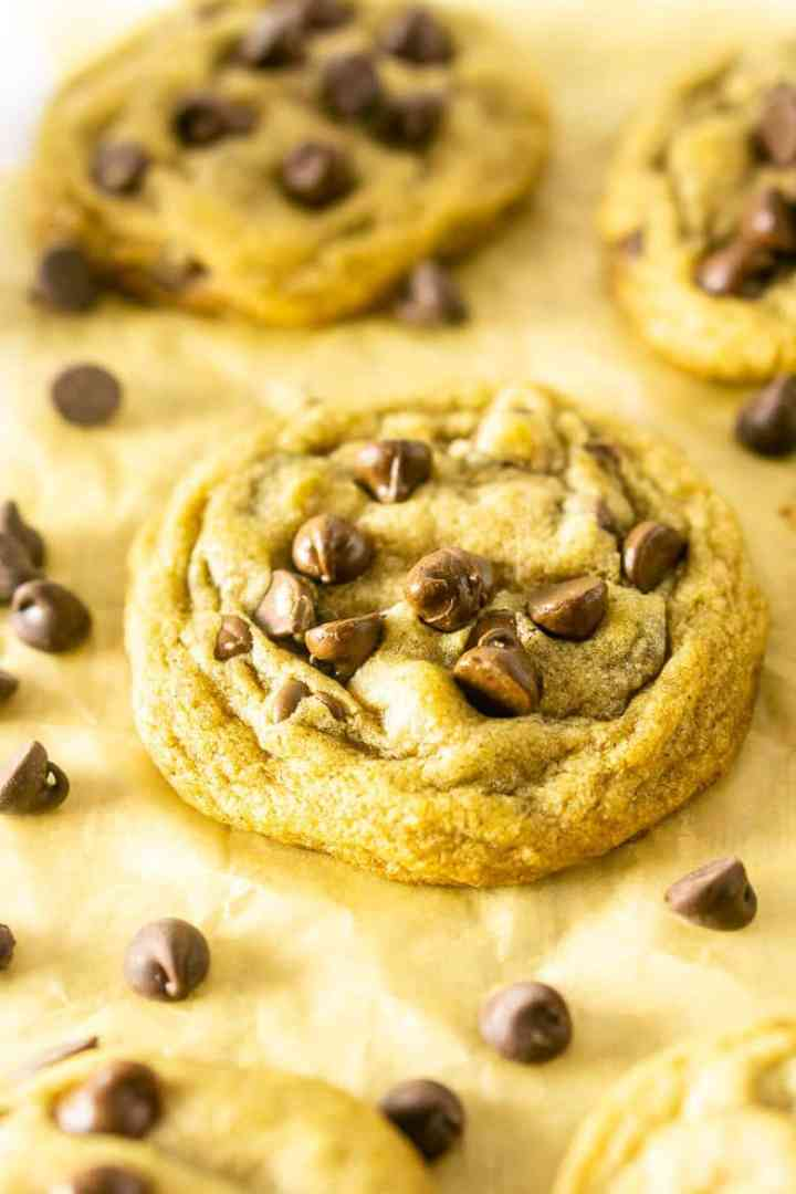 A single brown butter chocolate chip cookie with chocolate chips.