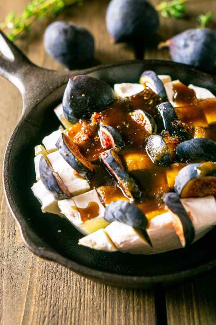 Brie cut into cubes with slices of figs and the Kahlua sauce poured on top.