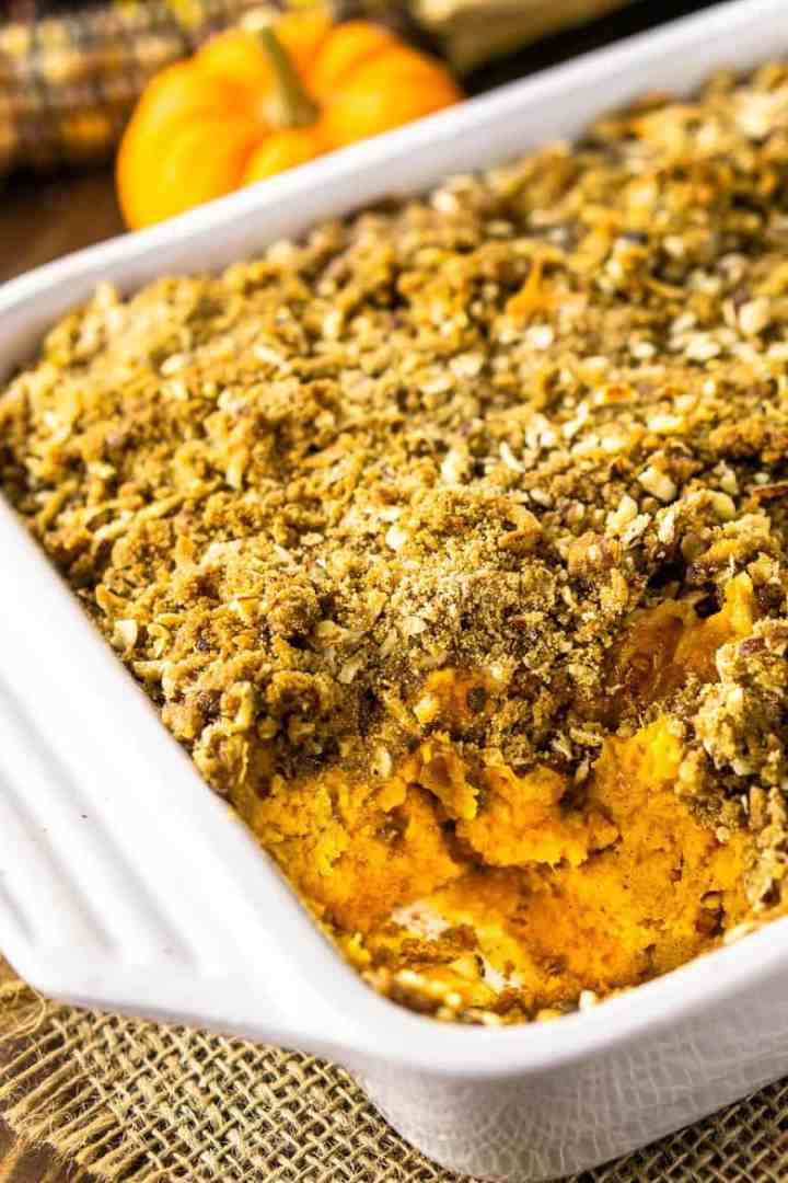 A close-up view of inside the sweet potato souffle to show both the sweet potato souffle and streusel texture.