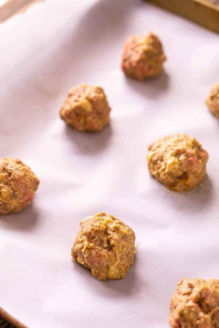 The formed meatballs onto a parchment paper-lined baking sheet.