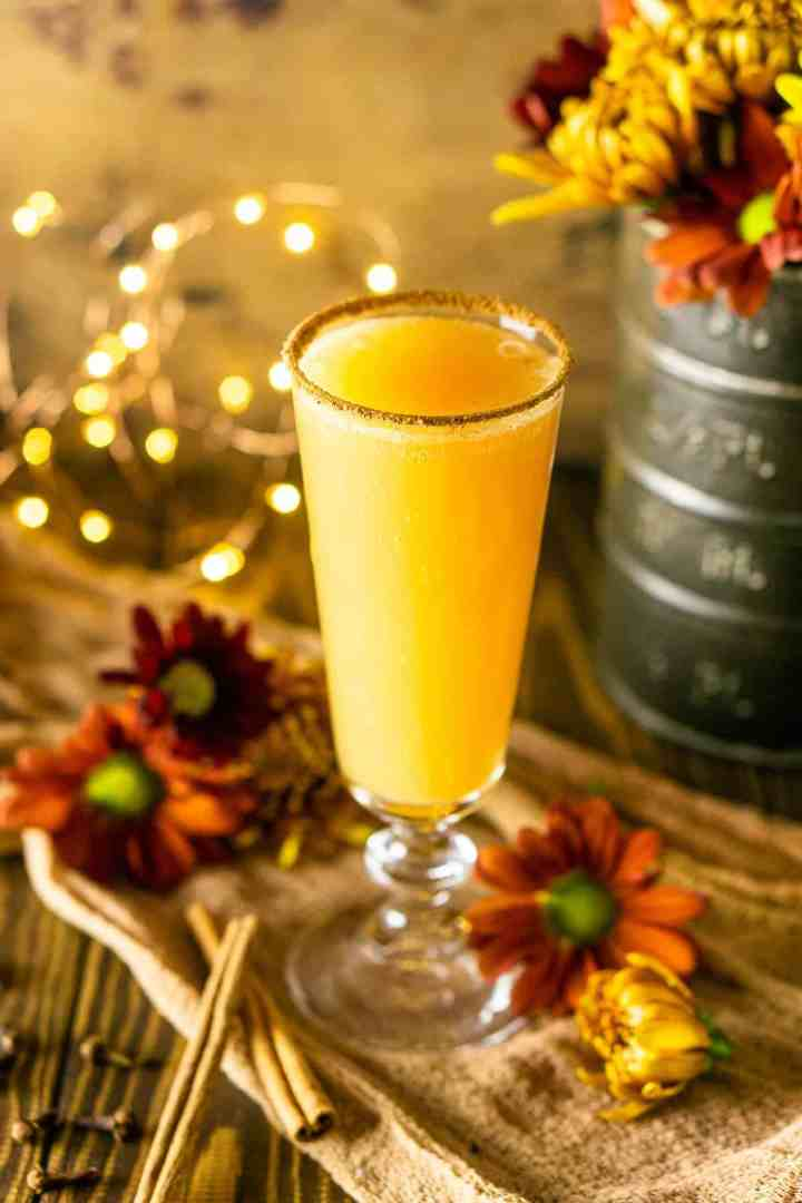 One autumn brunch cocktail with fall flowers around it.