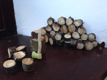 Axe amongst the logs