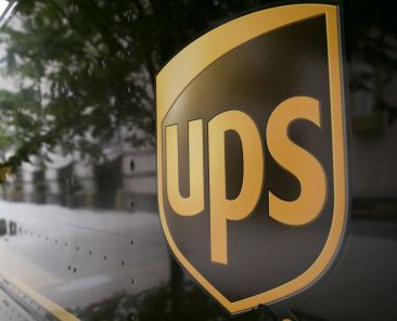 The United Parcel Service Inc. (UPS) logo is seen on the side of a delivery truck in Washington, D.C., U.S., on Monday, July 22, 2013. UPS is expected to release earnings data on July 23. Photographer: Andrew Harrer/Bloomberg via Getty Images
