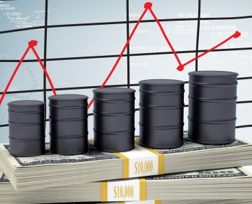 Barrels oil stand on pack of dollars. Schedule price changes in the background