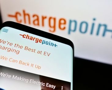 Stuttgart, Germany - 02-26-2021: Cellphone with website of US electric vehicle charging company ChargePoint Holdings on screen in front of logo. Focus on top-left of phone display. Unmodified photo.