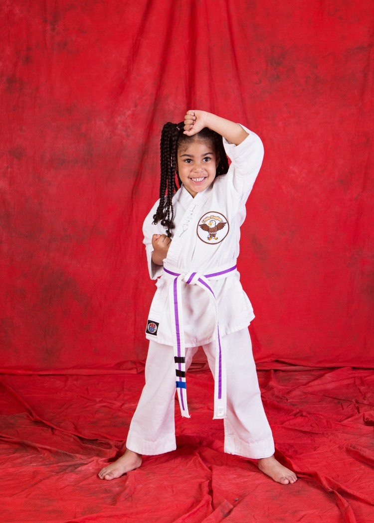 preschool girl in Little Eagles Martial Arts uniform